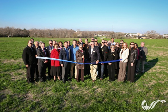 City officials and members of the B/CS Chamber of Commerce cut the ribbon.