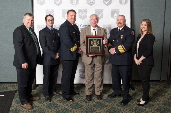 (L-R): CFAI Peer Team Leader Scott Avery, Driver/Engineer Stuart Marrs, Assistant Chief Paul Gunnels, CFAI Commission Chair Steven Westermann, Fire Chief Eric Hurt, Public Education Officer Christina Seidel.