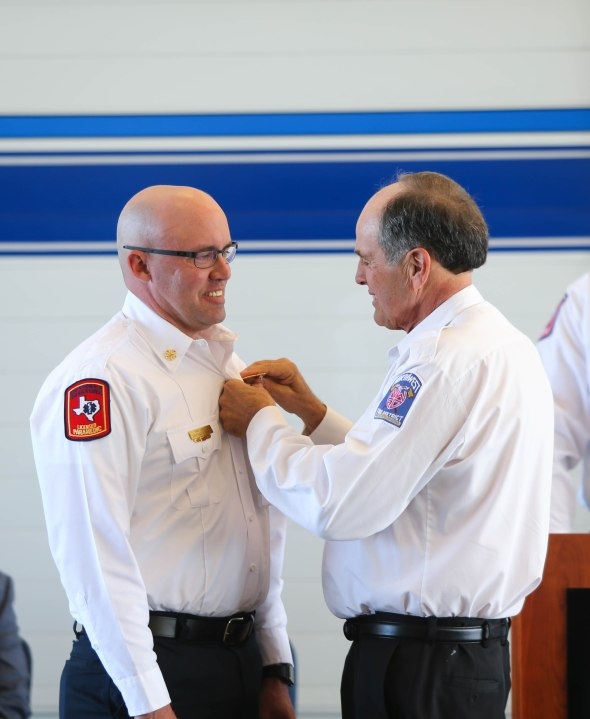 Chief McMahan received his pin from Chief Michael Brandt of Arizona's Northwest Fire District.