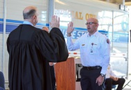 Judge Ed Spillane administers the oath to new Fire Chief Jonathan McMahan in February.