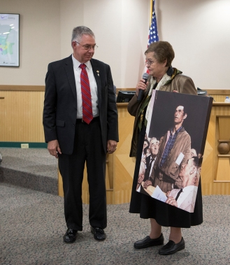 """As Mayor Karl Mooney looked on, outgoing Councilwoman Blanche Brick donated a print of Norman Rockwell's famous """"Freedom of Speech"""" to adorn the walls at College Station City Hall."""