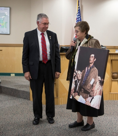 "As Mayor Karl Mooney looked on, outgoing Councilwoman Blanche Brick donated a print of Norman Rockwell's famous ""Freedom of Speech"" to adorn the walls at College Station City Hall."