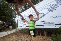 A young visitor explores his wingspan during the grand opening of the Lick Creek Park Nature Center in October.