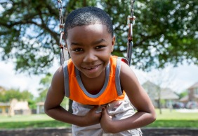A youngster takes a break from the Easter Egg Hunt to enjoy the new playground equipment at W.A. Tarrow Park.