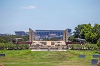 Kyle Field looms in the background in a picturesque view from the Aggie Field of Honor and Municipal Cemetery.