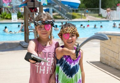 Two pirates ferociously guard Adamson Lagoon on Pirate Day in July.