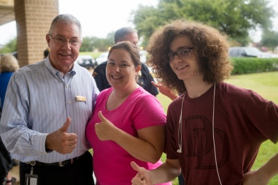 Mayor Karl Mooney hangs out with some enthusiastic residents on National Night Out.