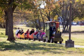 Children go for a train ride through Tarrow Park on a perfect December day as part of the annual Breakfast with Santa event at the Lincoln Recreation Center.