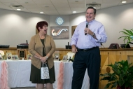 City Secretary Sherry Mashburn shares a laugh with City Manager Kelly Templin at her retirement party in July.
