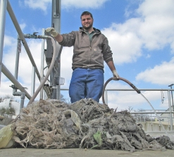 Water Production Operator Jared Lapaglia surveys a mass of non-flushables cleared from a waterwater pump.