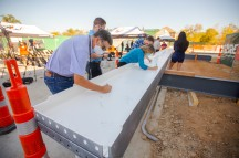 A topping ceremony was held in November for the new College Station City Hall. City council members, construction works, former and current city employees left their mark on the final beam to be installed.