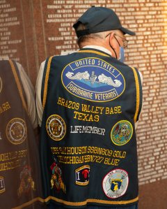 A veteran proudly displays his vest while participating in the annual Veterans Day ceremony at Veterans Park & Athletic Complex.