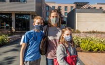 A mask-wearing family shops in Century Square. The COVID-19 pandemic came to be symbolized by the ubiquitous face coverings.