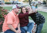Visitors to Century Square pause to take a selfie on The Green.